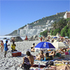 Holiday makers enjoying Clifton Beach with Vacation Accommodation on the beach